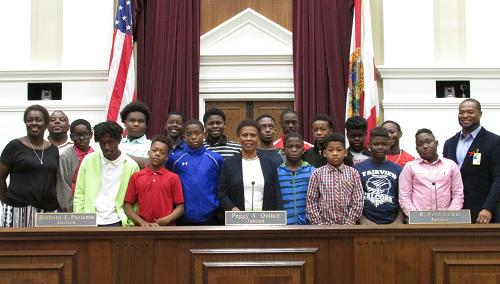 Dispute Resolution Center staff also conduct trainings for some of the state's youngest mediators. In October 2018, Fairview Middle School students studying conflict resolution skills marked Mediation Week with a visit to the supreme court. In addition to having an opportunity to hear Justice Quince speak and to pose for a photo with her (see above), they participated in a variety of education sessions.